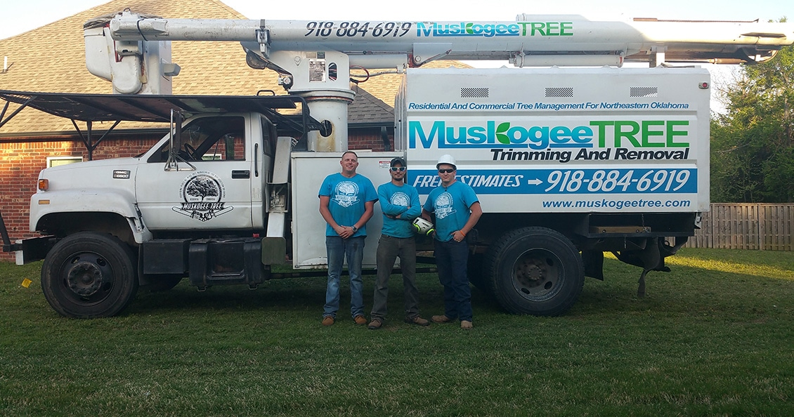 An image of the crew posing in front of our Bucket Truck.